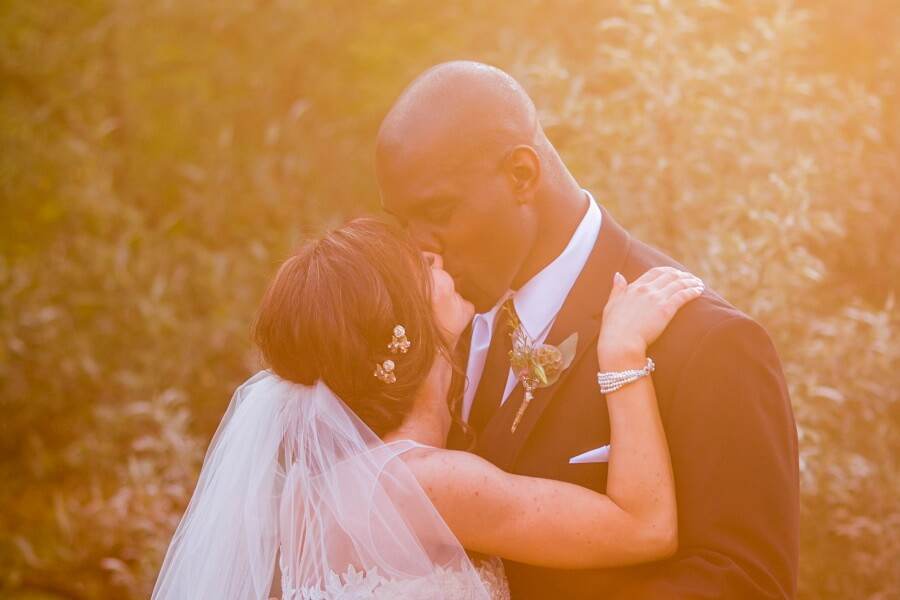 Married Couple Kissing Wedding Photography