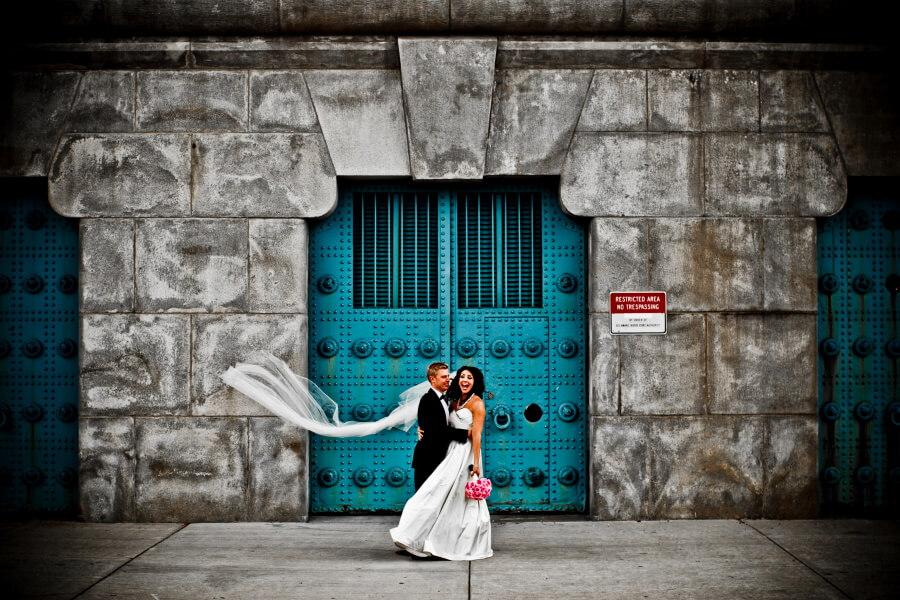 Newlyweds In Front Of Blue Door Wedding Photography
